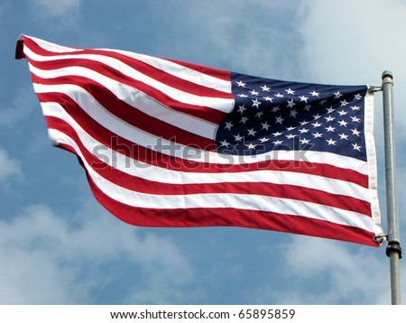 USA flag in blue sky background - stock photo