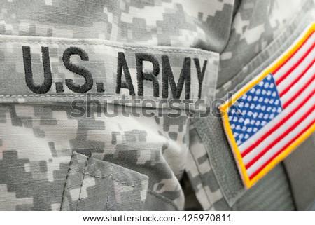 USA flag U.S. ARMY patch on military uniform - close up shot - stock photo