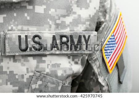 USA flag U.S. ARMY patch on military uniform - close up studio shot - stock photo