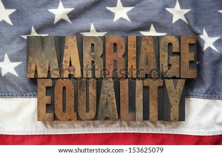 USA flag with the words 'marriage equality' - stock photo