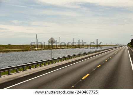 usa florida, road along a water canal