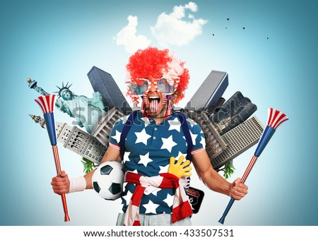 USA football fan in a red wig and horns - stock photo