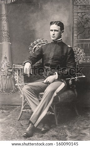 USA - Georgia - CIRCA 1895 An antique vintage photo of a United States Cavalry Soldier in his uniform. He is holding a sword. CIRCA 1895 - stock photo