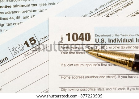 USA IRS tax form 1040 for year 2015 with ballpoint pen and taken from above - stock photo