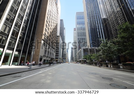 USA, NEW-YORK - AUG 23, 2014: Cityscape with road and trees near Hilton hotel. - stock photo