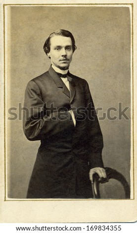 USA - NEW YORK - CIRCA 1863 - A vintage Cartes de visite photo of a young gentleman. The man is standing with one arm inserted into his coat. A photo from the Civil War era. CIRCA 1863  - stock photo