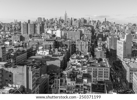 USA, NEW YORK CITY - April 27, 2012: New York City Manhattan skyline aerial view with street and skyscrapers.  colorless photo  - stock photo