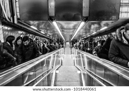 USA/NEW YORK - 3 JAN 2018 - people in the daily life of the New York subway. Climbing Stairs.
