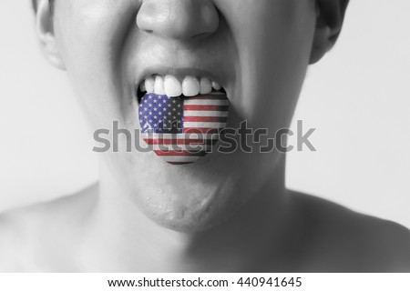 USA or United States flag painted in tongue of a man - indicating English language and American accent speaking, study in America concept in Black and White - stock photo