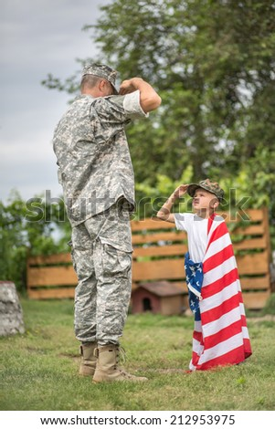 USA patriots concept. Father salutes his son. focus on father - stock photo