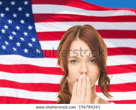 usa politics, conspiracy and secrecy concept - woman with hand over mouth on american flag background - stock photo