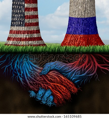 USA Russia cooperation and partnership business and diplomatic concept of working together as two growing trees with flags painted on with roots shaped as shaking human hands in agreement. - stock photo