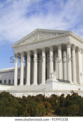 USA Supreme Court building in Washington, D.C. with a blue cloudy sky background. - stock photo