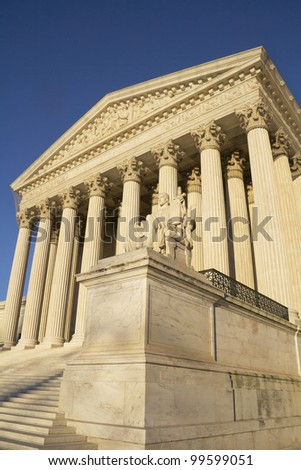 USA Supreme Court building in Washington, D.C. with a blue sky background. - stock photo