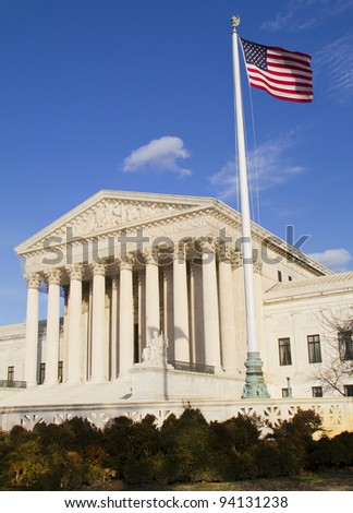 USA Supreme Court building in Washington, D.C. with an American flag and pole - stock photo