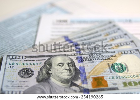 USA Tax Form 1040 with new 100 US dollar bills. business concept - stock photo