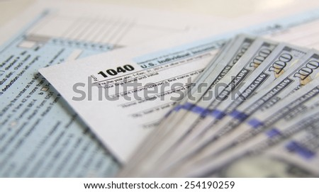 USA Tax Form 1040 with 100 US dollar bills. business concept - stock photo