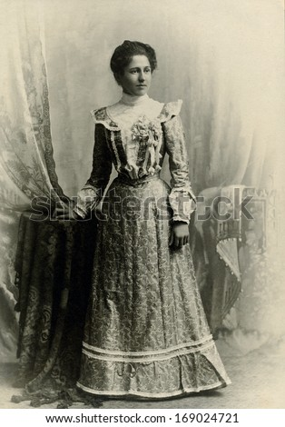 USA - WASHINGTON DC - CIRCA 1890 - A vintage antique photo of a young woman standing. The woman is dressed in a Victorian style dress. A photo from the Victorian era. CIRCA 1890 - stock photo