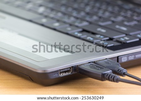 USB cable is connecting to laptop computer