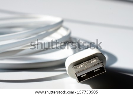 USB connector on white background with shadows. - stock photo