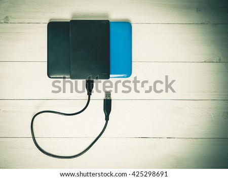 USB External Hard disk tacked on wooden Vintage - stock photo