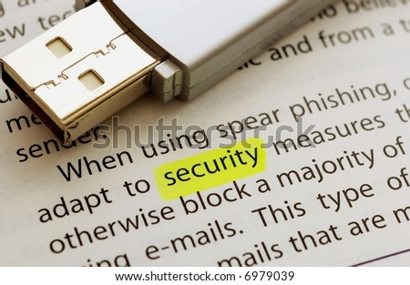 USB flash drive next to the word security - stock photo
