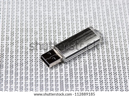 USB flash drive on the background of a binary code - stock photo
