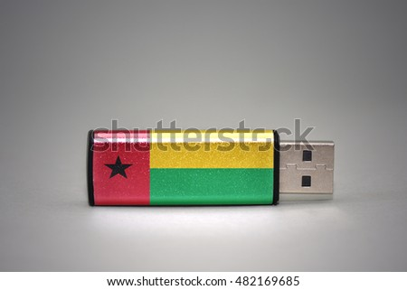 usb flash drive with the national flag of guinea bissau on gray background. concept