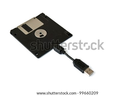 USB Floppy Disk connecting the Past with the Future - stock photo