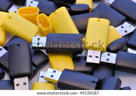 usb memory sticks - black and yellow - stock photo