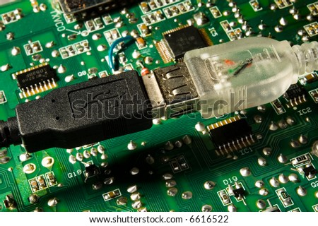 USB plug attached to another plug over circuit board
