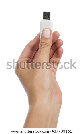 USB stick in hand isolated over white background.