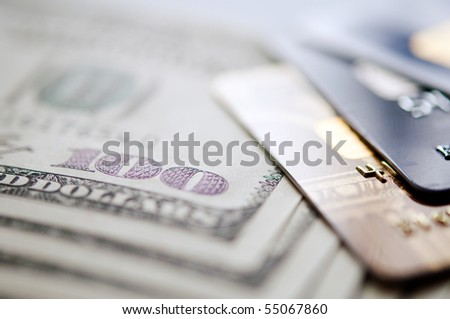 USD and credit card. selective focus. closeup.