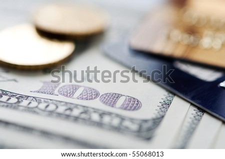 USD banknote, coins and credit card. selective focus. closeup.