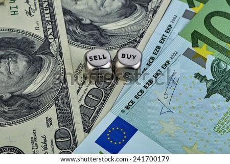 USD EUR banknotes, dices cubes. Selecnive focus - stock photo