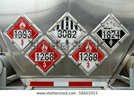 USDOT Hazardous Materials Transportation Placards on rear of a Fuel Tanker - stock photo