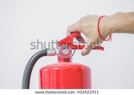Use fire extinguisher. - stock photo