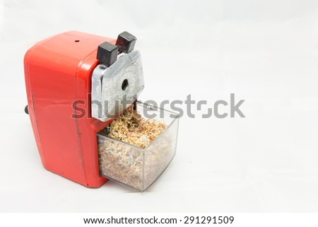 Use sharpener of pencil on the white background - stock photo