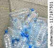 used and damaged plastic bottles in a container - stock photo