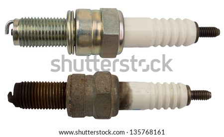 Used and new sparkplug, isolated against background - stock photo