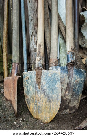 Used and worn gardening tools in a shed, waiting spring farm work - stock photo