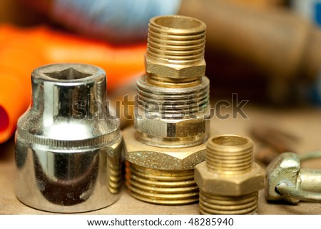 used and worn threaded plumbing install pipes and joints - stock photo