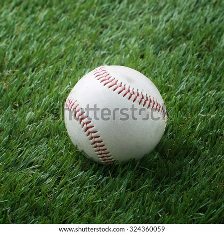 used baseball on artificial grass.