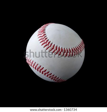 Used baseball on black, shallow DOF. - stock photo