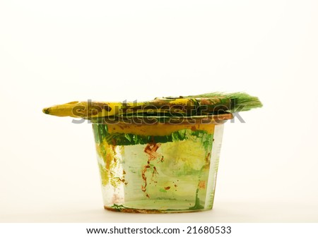 Used brush and plastic pail isolated on white - stock photo