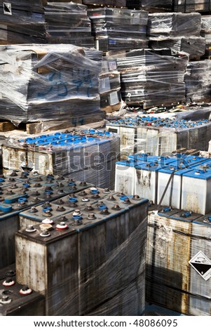 Used Car Batteries Sitting on Pallets Waiting To Be Recycled - stock photo