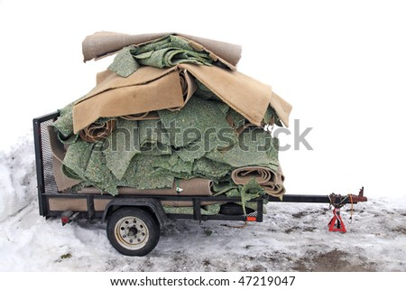 Used carpet and padding loaded on trailer to be transported to the dumping area