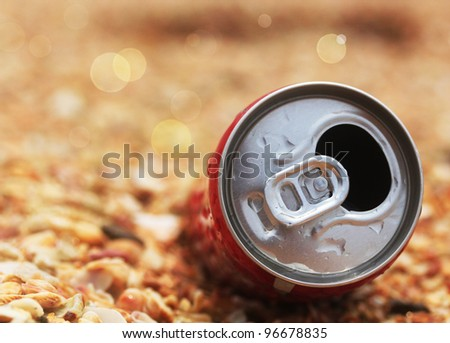 Used cola can top opened with bokeh in the background - stock photo
