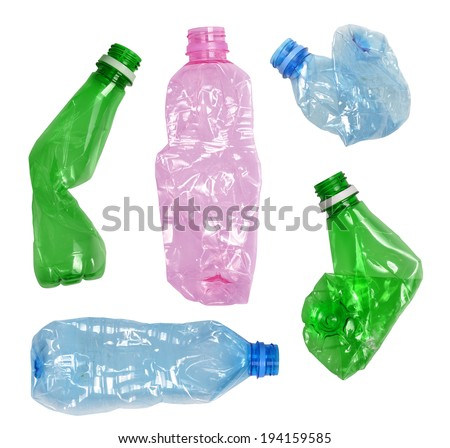 Used crumpled plastic bottles isolated on white - stock photo