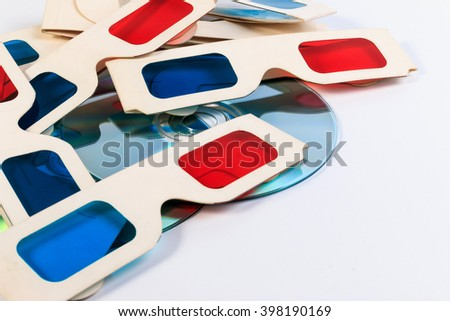 Used 3D paper glasses and DVD disc isolated on white background. - stock photo